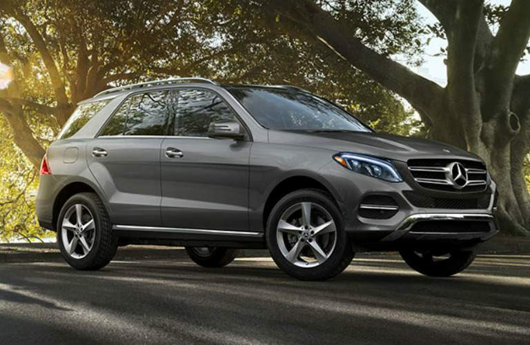 Gray 2018 Mercedes-Benz GLE parked by big tree