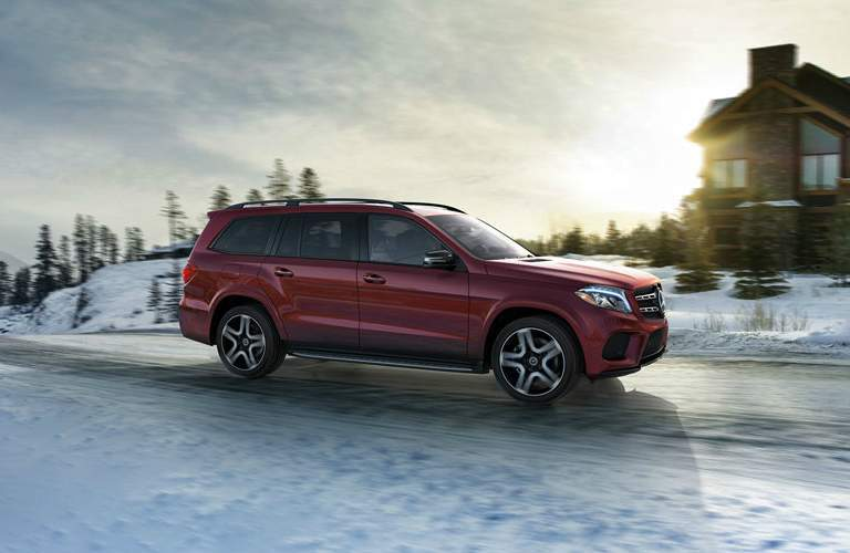 red 2018 Mercedes-Benz GLS driving on snowy road