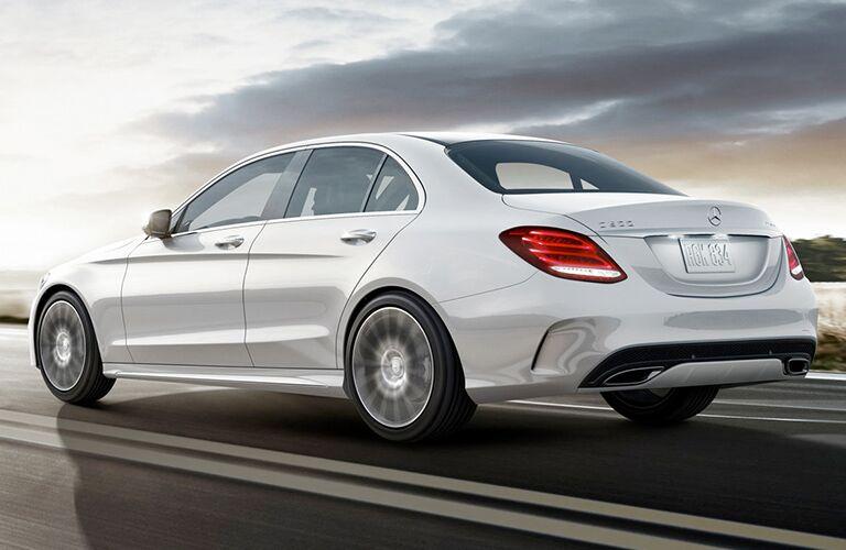 White 2019 Mercedes-Benz C-Class sedan drives down a highway.