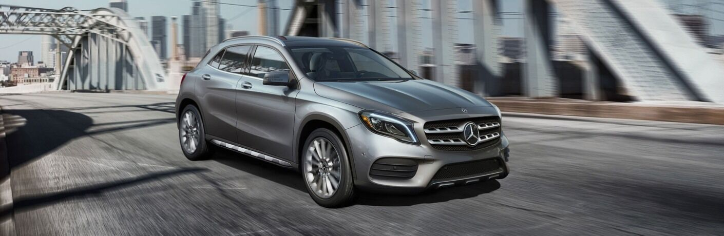 Silver 2019 Mercedes-Benz GLA driving over bridge