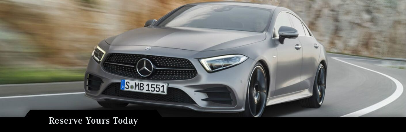 Silver 2019 Mercedes-Benz CLS driving on windy road