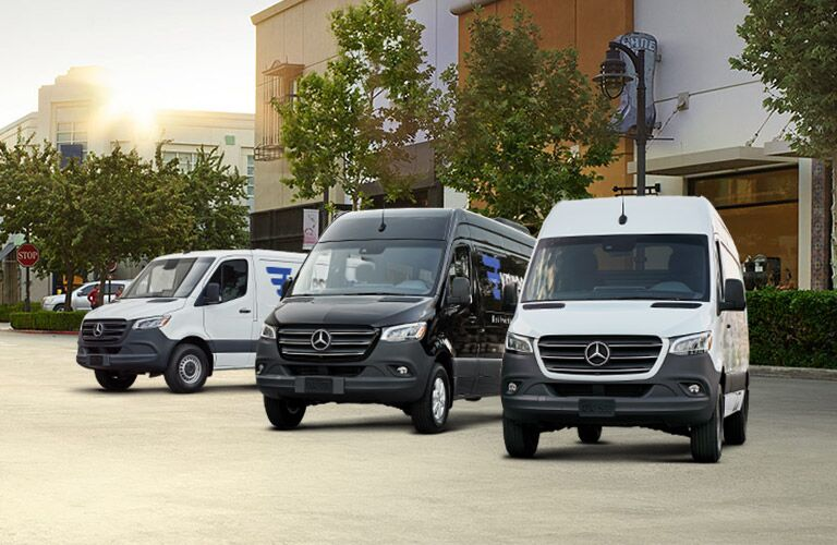 Three Mercedes-Benz vans parked together