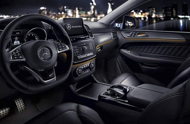 2017 mercedes-benz gle interior with infotainment system shown in front of new york city skyline