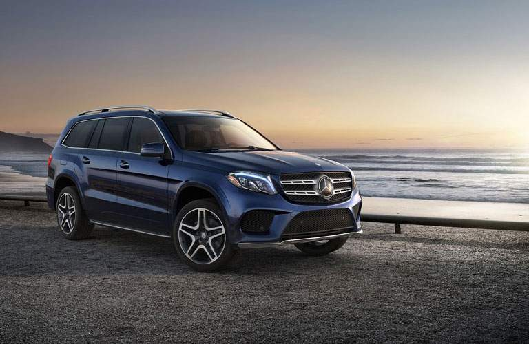 2017 Mercedes-Benz GLS SUV parked by a beach and ocean railing