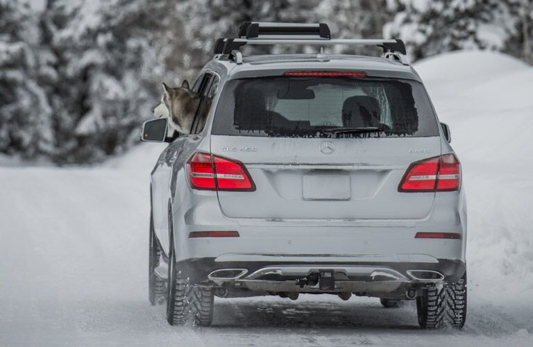 white 2017 Mercedes-Benz GLS rear end driving in snow