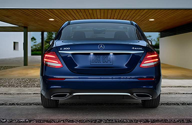 rear bumper and design of 2018 mercedes-benz e-class sedan shown in a car port in affluent southern california home