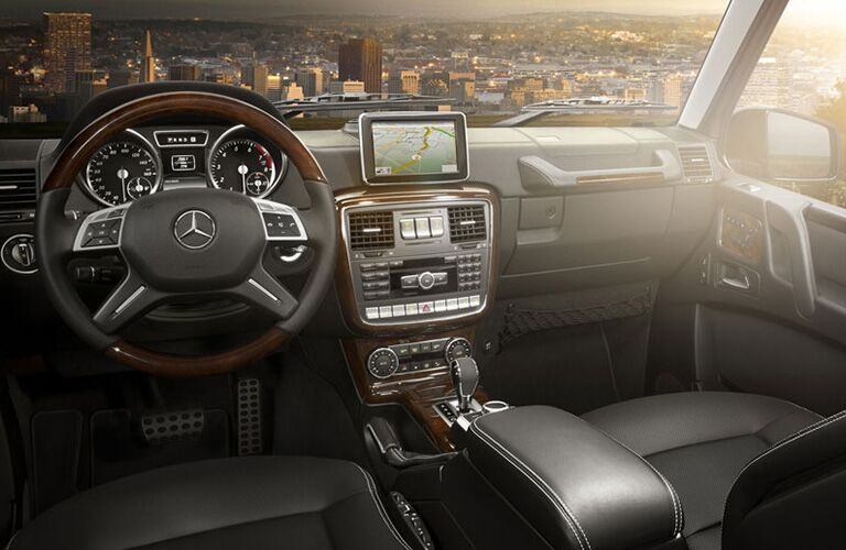 2018 Mercedes-Benz G-Class interior front seating with dashboard, steering, and transmission