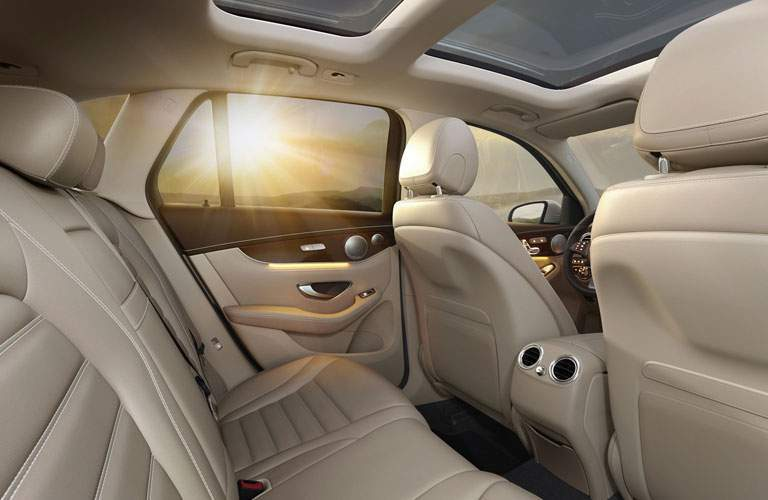 2018 Mercedes-Benz GLC interior back seat view of seating upholstery and sunset outside background