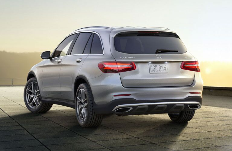 2018 Mercedes-Benz GLC exterior rear shot of back bumper, taillights, and trunk parked on a tile platform