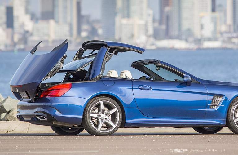2018 Mercedes-Benz SL roadster exterior shot parked on beach as convertible hard top retracts and folds