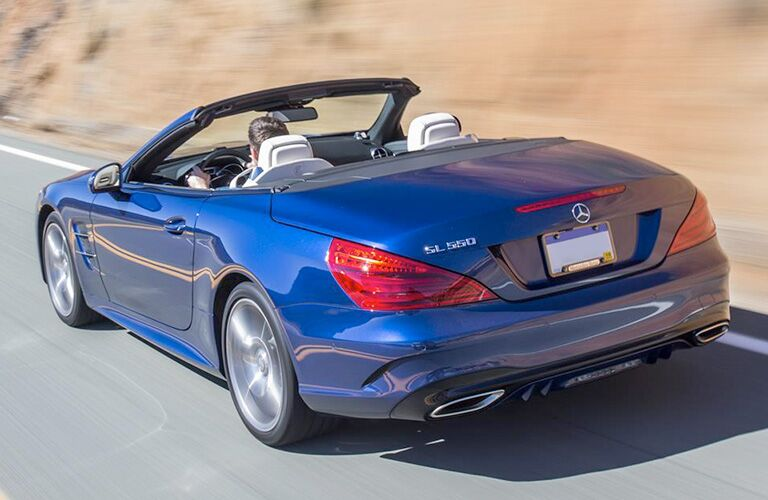 2018 Mercedes-Benz SL roadster exterior back shot of blue paint coat driving on a mountain highway