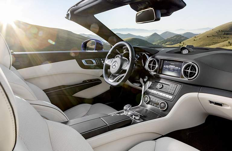 2018 Mercedes-Benz SL Roadster interior front seating and steering with sun glare