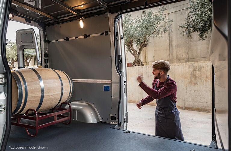 2018 Mercedes-Benz Sprinter cargo van interior cargo space loaded with barrels