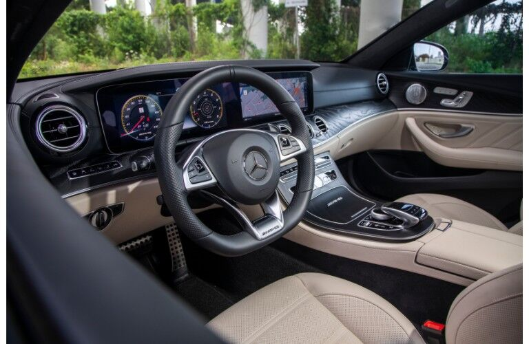2018 Mercedes-AMG E 63 S Wagon interior shot front seating view of steering wheel and electronic dashboard