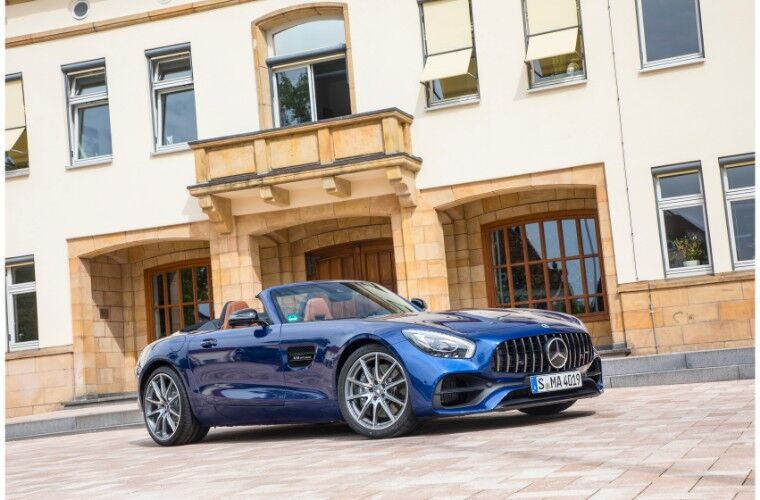 2018 Mercedes-AMG GT exterior shot blue paint parked on tile next to brick and paste building