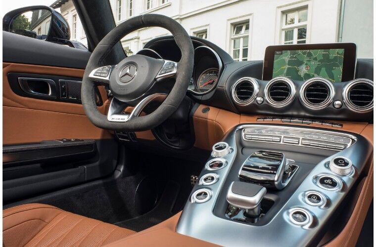 2018 Mercedes-AMG GT interior shot of front seat driver's view dashboard, transmission,touchscreen, and steering wheel