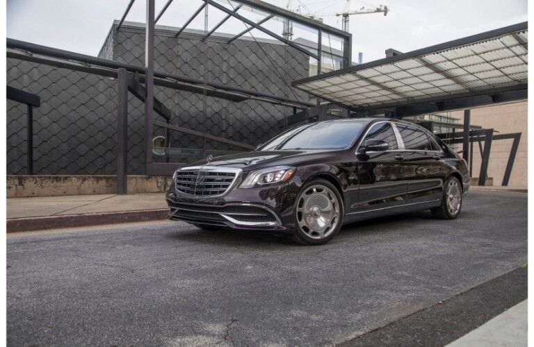 2018 Mercedes-Maybach luxury sedan exterior shot parked outside of a construction modern building