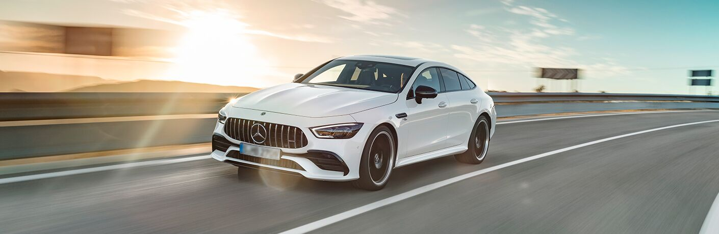 2019 Mercedes-AMG GT 4-door coupe exterior shot driving on a sunny highway