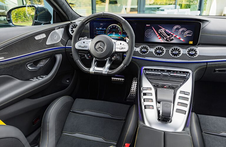2019 Mercedes-AMG® GT 4-door coupe interior shot of driver's seat, steering wheel, transmission, and dashboard technology