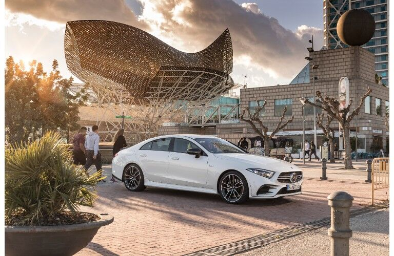 2019 Mercedes-AMG CLS 53 exterior shot parked on a tile walkway in front of a busy, building as people walk by