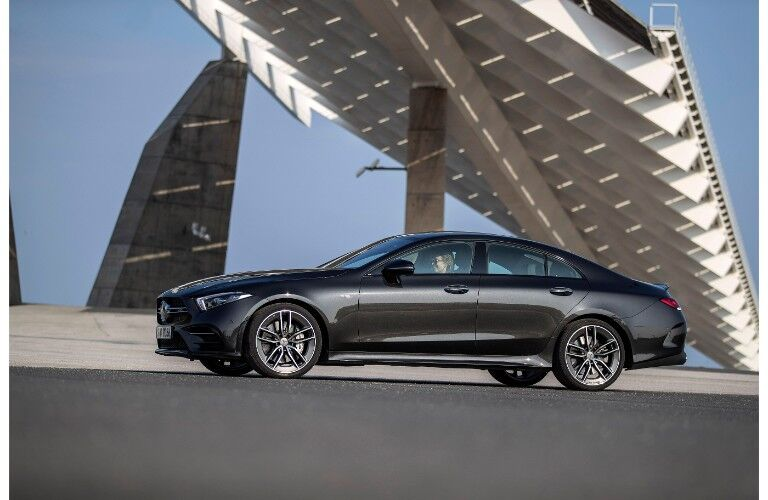 2019 Mercedes-AMG CLS 53 exterior side shot black paint job parked under a winding bridge with a blue sky