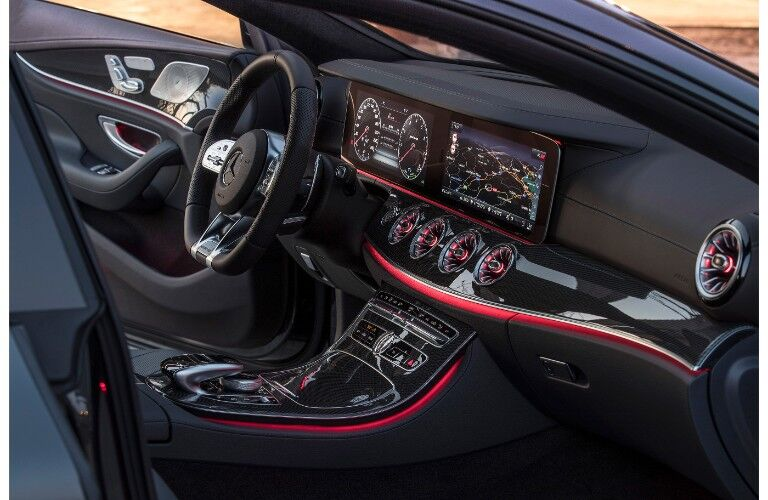 2019 Mercedes-AMG CLS 53 interior shot interior side shot of red lit dashboard and infotainment screens and knobs