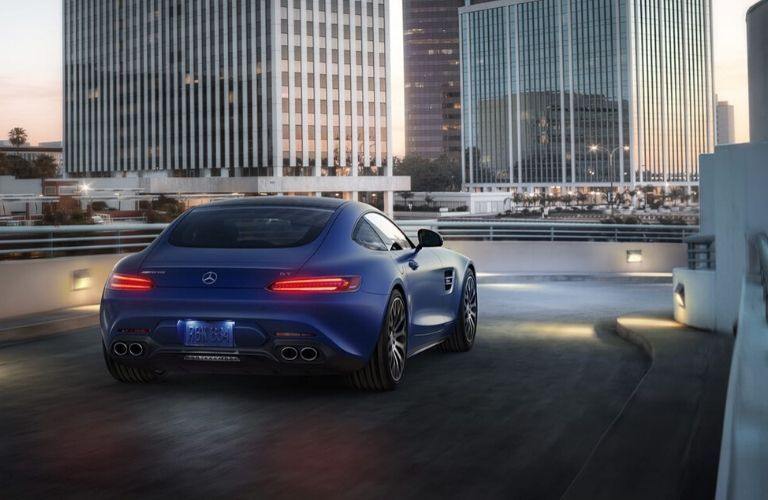 2020 Mercedes-AMG GT driving in the city shown from exterior passenger rear