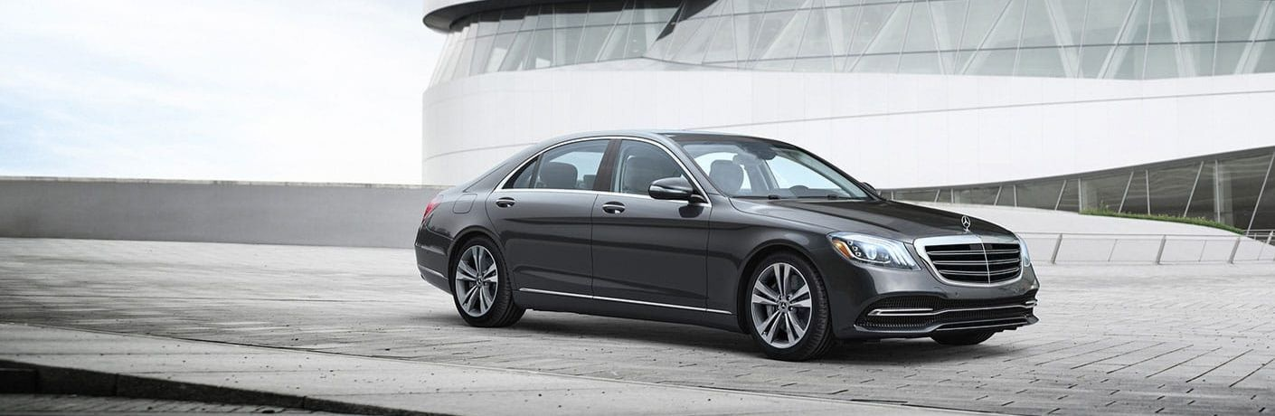 2020 Mercedes-Benz S-Class parked in front of parking garage building from exterior front passenger side