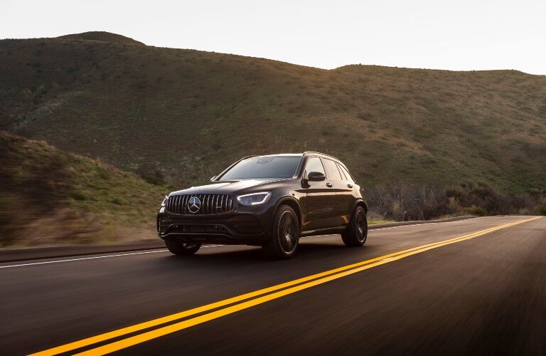 Black 2021 Mercedes-Benz GLC SUV from exterior front on highway