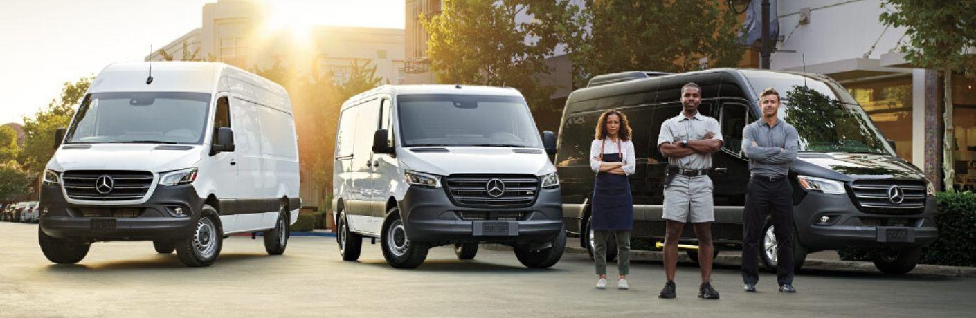 Crew standing in front of 2020 Mercedes-Benz sprinter vans