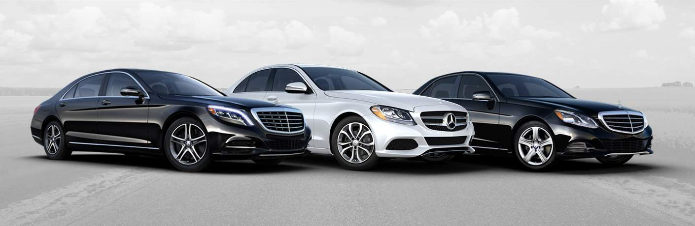 Mercedes-Benz passenger vehicle lineup with cloud background