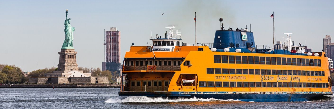 Staten Island Ferry in front of Statue of Liberty