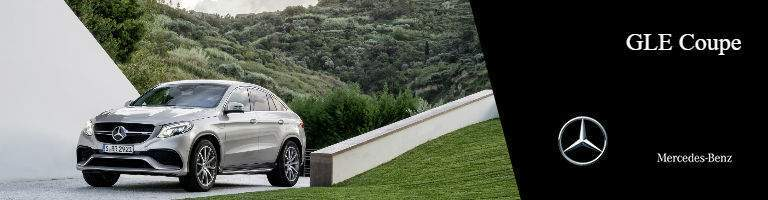 Mercedes-Benz GLE Coupe parked next to grassy hillside bridge