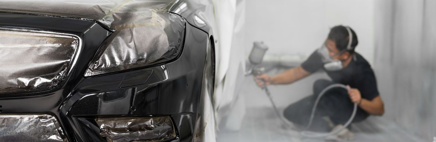 man repairing paint and scratches in a Mercedes-Benz