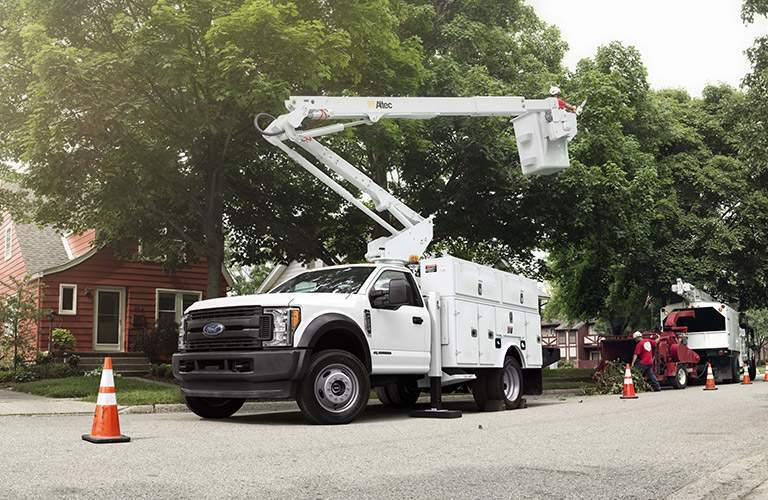 2017 Ford Super Duty Chassis Cab working on power lines