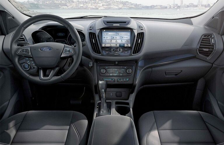 Dashboard and Dark Grey Front Seats of 2018 Ford Escape