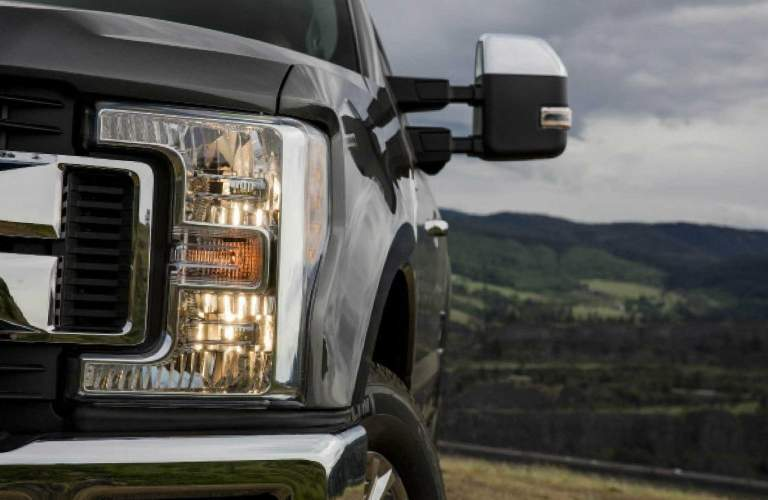 Driver's Side Headlight and Rearview Mirror of 2018 Ford F-250 Super Duty