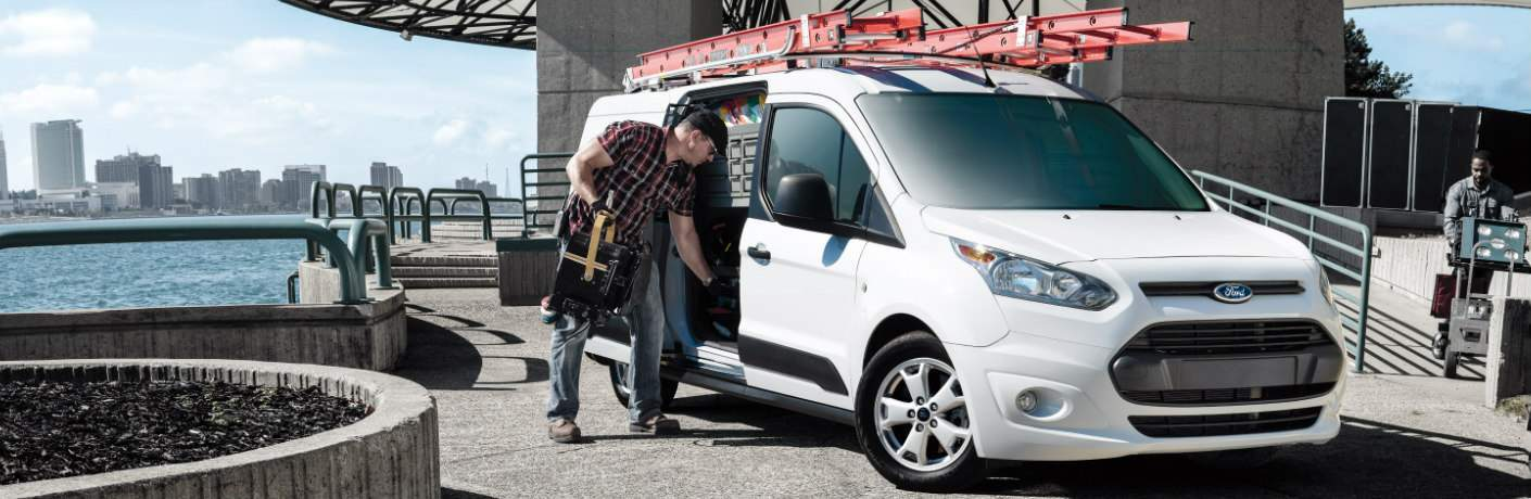 Man by the Sliding Door of White 2018 Ford Transit Connect Cargo Van