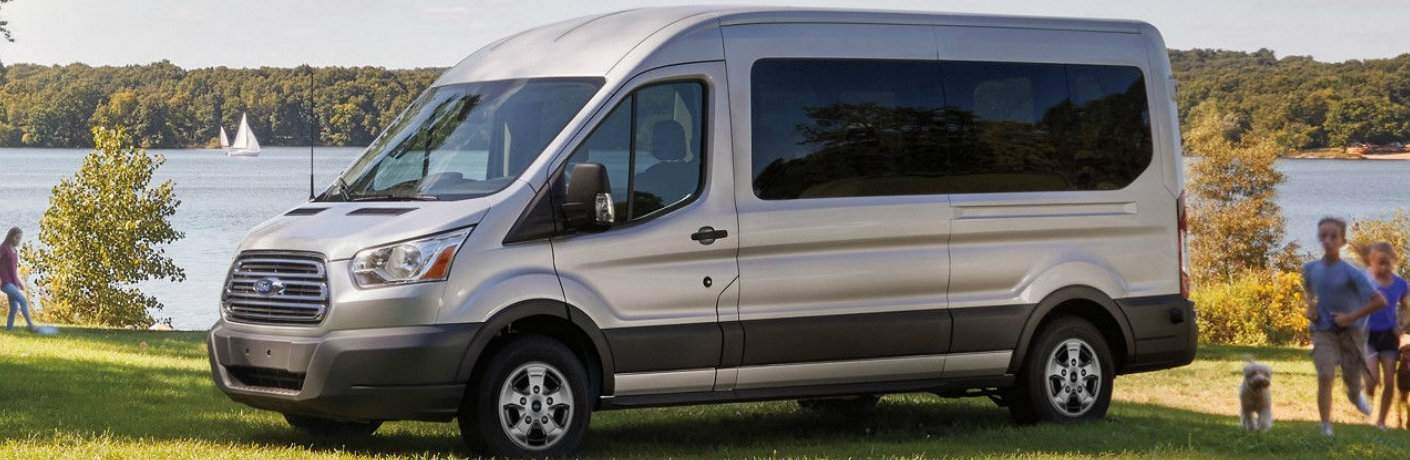 Silver 2018 Ford Transit Passenger Wagon Parked by a Lake