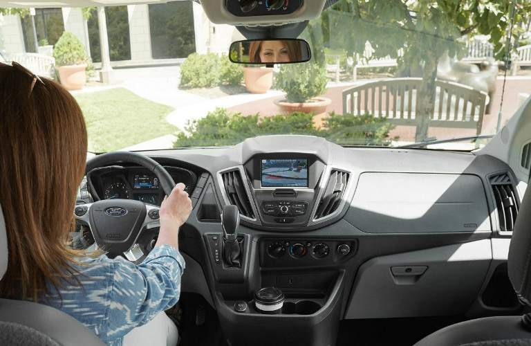 Woman Looking at Rearview Mirror of 2018 Ford Transit Passenger Wagon