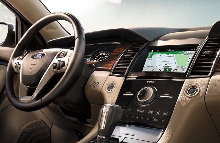 Steering wheel, gauges, and touchscreen in 2019 Ford Taurus