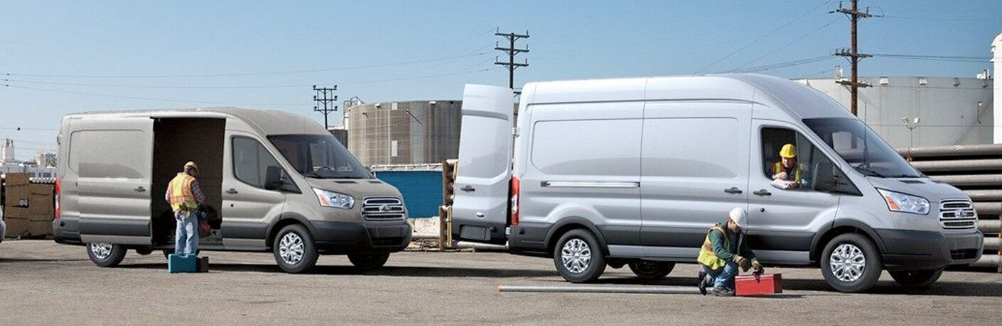 Two 2019 Ford Transit Cargo Vans parked near a chemical plant