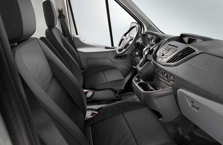 Dashboard and black seats in 2019 Ford Transit Cargo Van