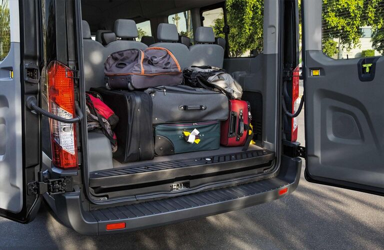 Luggage in the cargo area of a 2019 Ford Transit Passenger Van