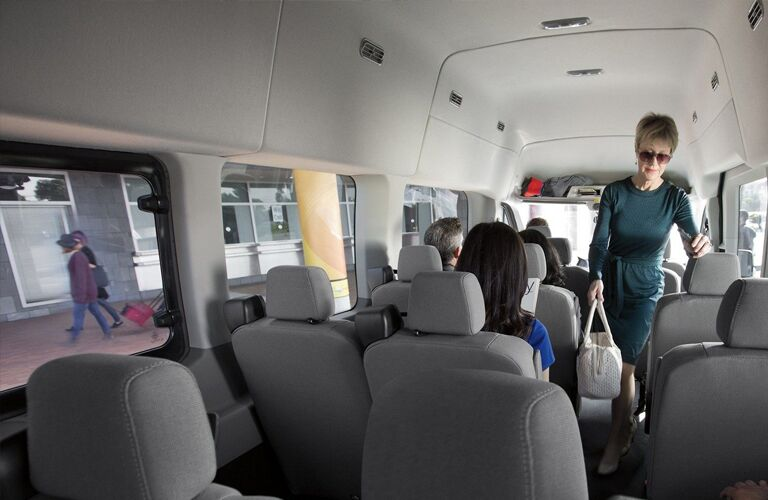 A woman walking in the cabin of a 2019 Ford Transit Passenger Van