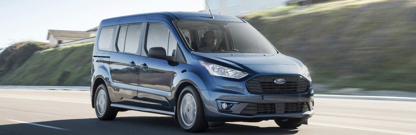 Blue 2019 Ford Transit Connect Wagon Driving on a Highway
