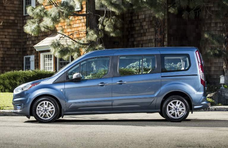 Blue 2019 Ford Transit Connect Wagon Parked near a Brown House