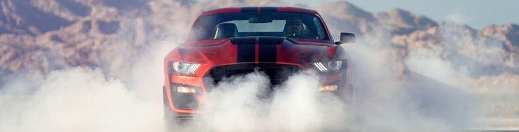 2020 Ford Mustang on a smoky racetrack