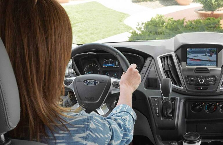 2020 Ford Transit Connect with a driver in the seat