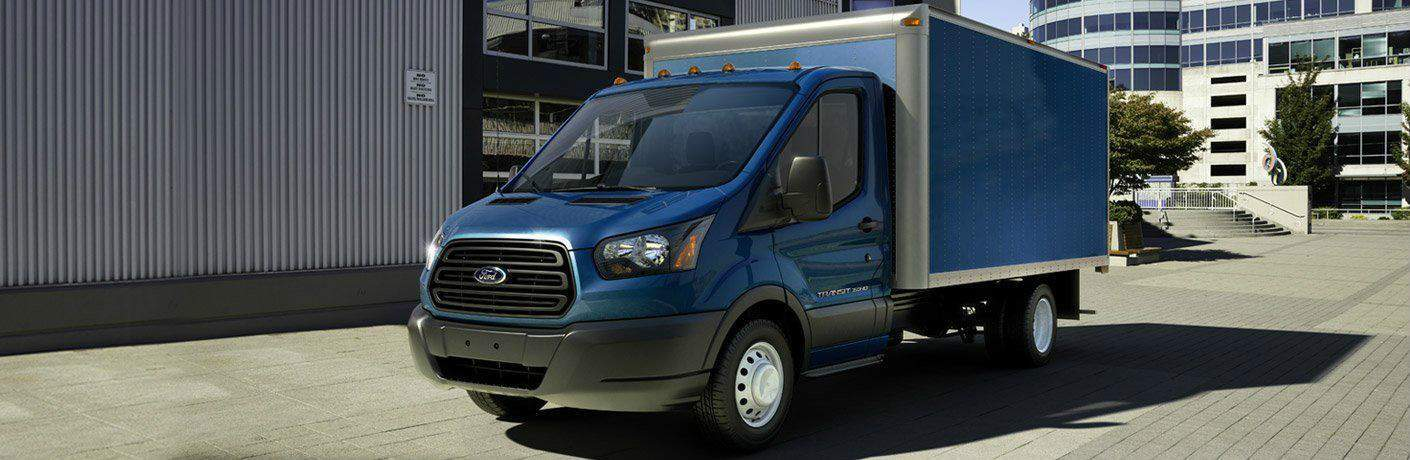 Blue 2018 Ford Transit Chassis Cab Parked by a Warehouse